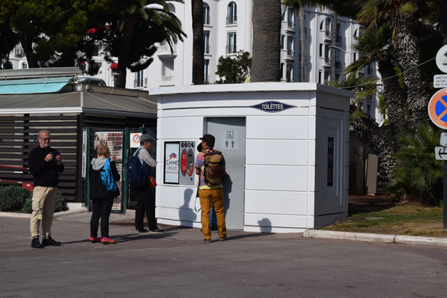 Paid sidewalk Restroom in Cannes France photo by charles davis