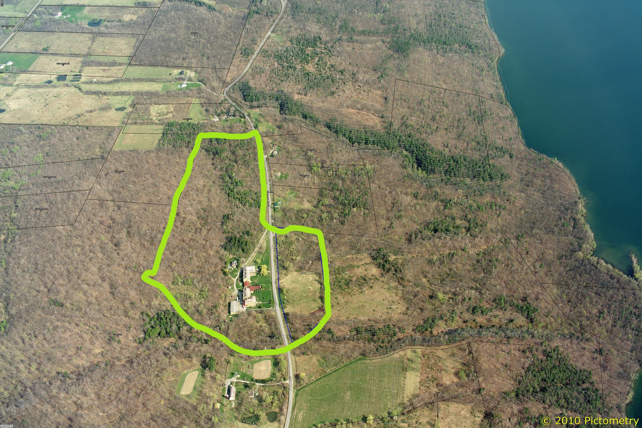 View of St Michael's Seminary and Mission and surrounding areas including Hemlock Lake, a finger Lake